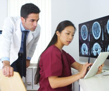 Diverse medical team working in the office together